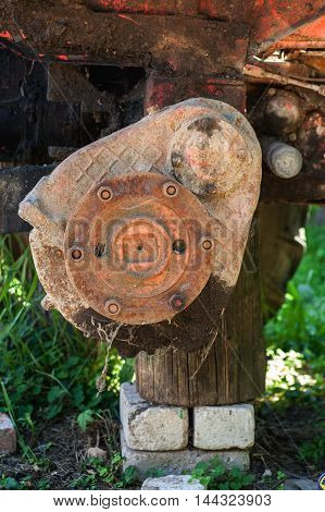 Rusty Wheel Hub On Wooden Stand