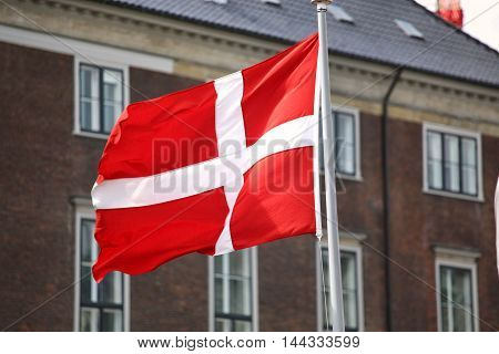 Waving Danish flag on the mast in Copenhagen Denmark