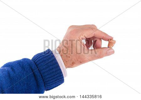 Close up of a senior man's hand showing a small CIC (completely In Canal) hearing aid
