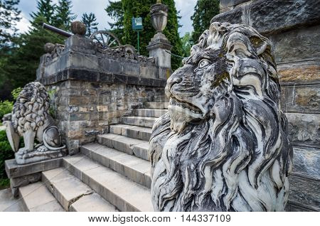 Lion statues in gardens of Peles Castle near Sinaia city in Romania poster