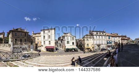 Panoramic View With People From Famous Arena In Arles To Old Town