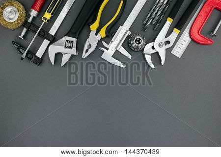 Pliers And Adjustable Wrenches, Ruler, Clamp, Vernier Caliper On Desk Top View
