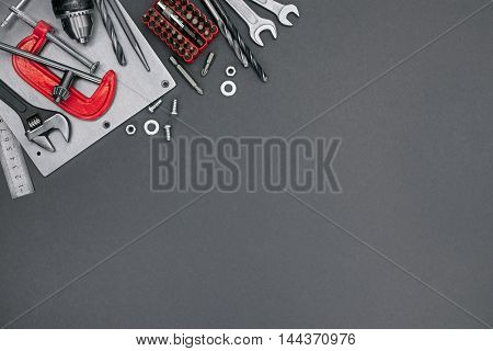 Clamp, Bolts And Screws, Bits, Adjustable Wrenches, Spanners And Drill On Grey Background