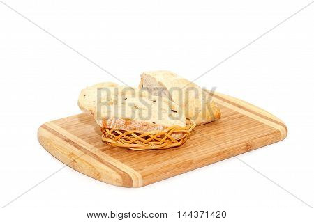 Close view of sliced bread lying on cutting board isolated over white background