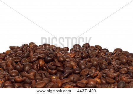 Close view of roasted coffee beans isolated over white background