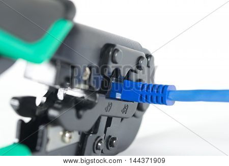Crimping tool for twisted pair on a white background isolated