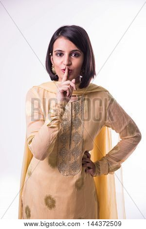Indian beautiful young Woman using Hand Signal Language to Tell You Keeping quite or keep silence or shhh