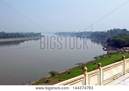 View on Yamuna River from Taj Mahal in Agra. India. The Yamuna sometimes called Jamuna is the longest and the second largest tributary river of the Ganges (Ganga) in northern India
