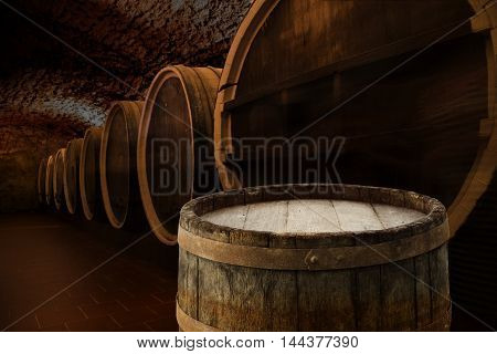 Antique Wine Cellar with Rusty Wooden Barrels.