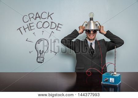 Crack The Code text with vintage businessman and machine at office