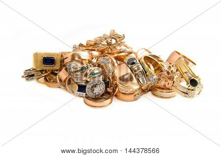 heap of gold jewelry isolated on a white background
