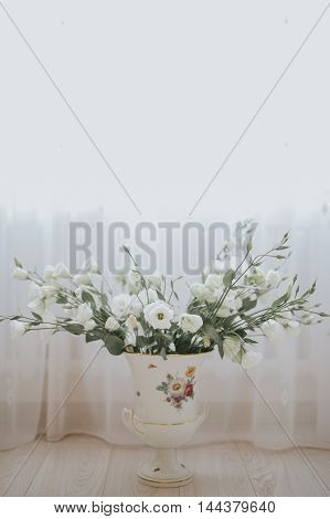 Wedding Bride Bouquet Of Flowers In A Vase On The Floor And Furn