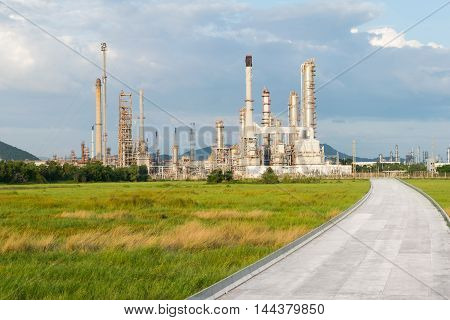 Petrochemical industry  power station with dirt road in afternoon of Thailand