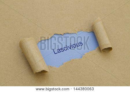 Lascivious word written under torn paper .