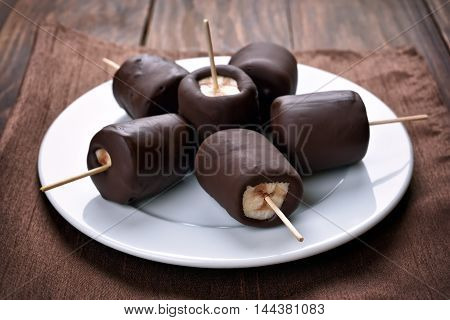 Fruit dessert frozen banana covered with chocolate