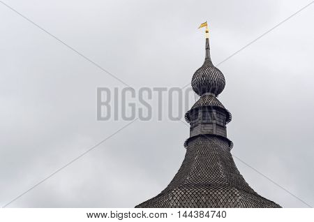 A wooden dome with a weather vane in Rostov Kremlin.