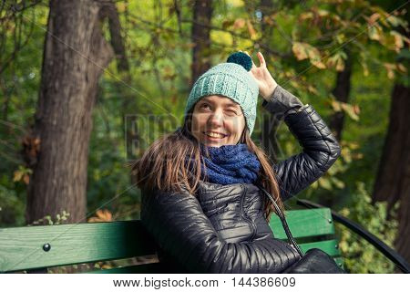 woman in a park in the knitted cap