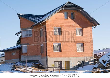 Brick house as Carcass in Winter with snow