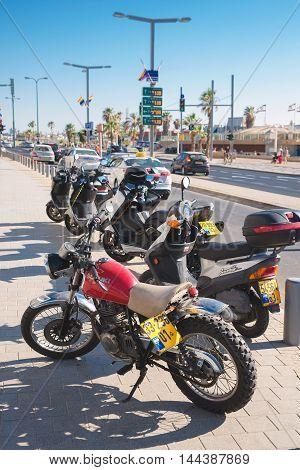 TEL AVIV, ISRAEL - JUNE 4, 2015: Motorcycle parking on the waterfront in Tel Aviv
