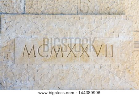 Nineteen Twenty Seven in Roman Numerals on Stone