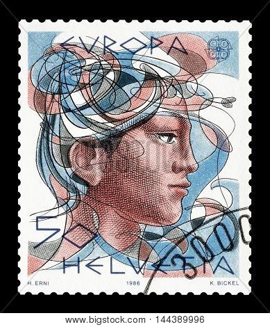 SWITZERLAND - CIRCA 1986 : Cancelled postage stamp printed by Switzerland, that shows head of a woman.