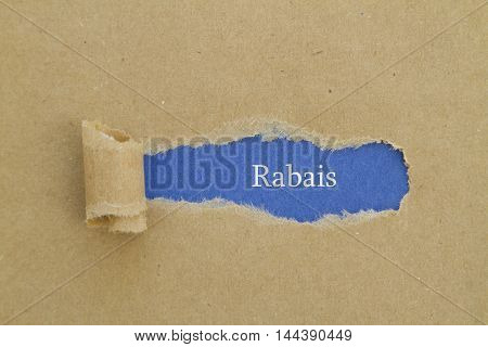French Word Rabais (Discount) written under torn paper.