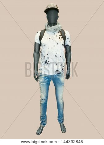 Full length male mannequin dressed in t-shirt and jeans isolated. No brand names or copyright objects.