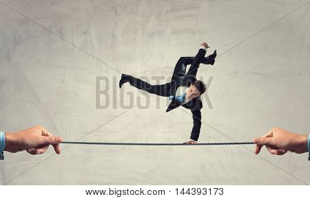 Young businessman breakdancer . Mixed media