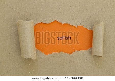 Selfish word written under torn paper .