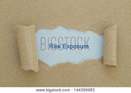 Risk Exposure written under torn paper .