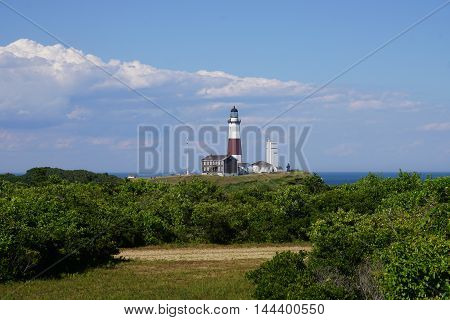 Atlantic ocean waves on the beach at Montauk Point Light, Lighthouse,, Long Island, New York, Suffolk County in Spring, early Summer