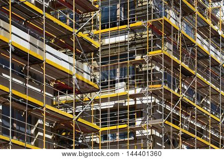 Scaffolding On Building , Building Facade With Scaffolds