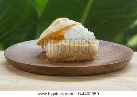 Choux Cream on plate / Cream puffs filled vanilla custard