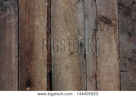 Knocked off pine boards together. Wood texture. Wooden background.