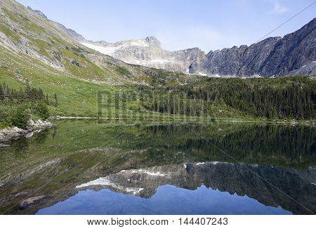 Calm waters of Upper Dewey Lake 3100 feet (945 meters) above sea level (Skagway Alaska).