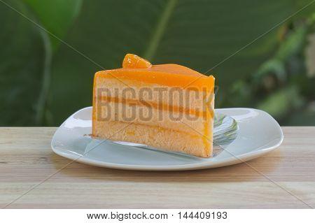 Piece of orange cake cream on the plate