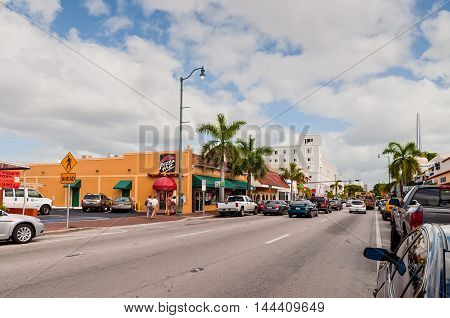 Miami Florida USA - November 25 2011: Tourists go toward the popular Calle Ocho in Little Havana Miami Florida USA. Calle Ocho is the heart of the exiled cuban american community.