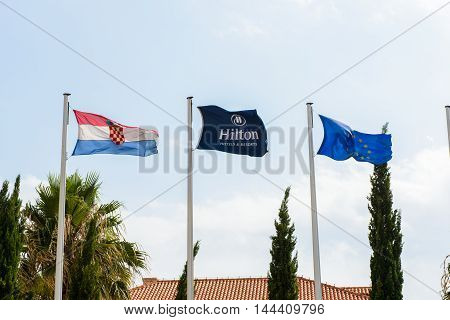 DUBROVNIK. CROATIA - AUG 21, 2014:  Flags of the Hotel Hilton Imperial in Dubrovnik, Croatia. Hotel is located near the the Pile Gate of the Old Town Of Dubrovnik. The hotel is built over a century ago