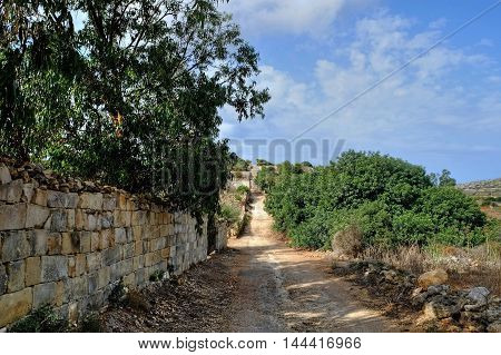 The roman road runs across the island of Malta from Xemxija, St Pauls on the east coast bay to Golden bay on the west coast.