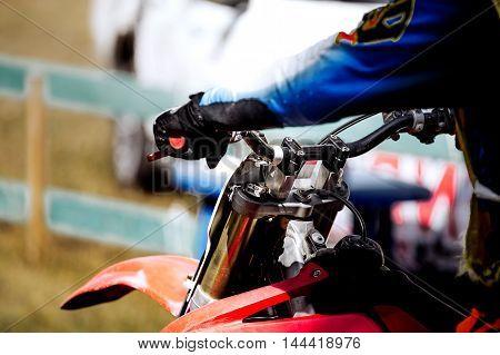 hands on handlebar racer motorcycle racing during race