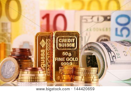 POZNAN POLAND - APR 2 2015: Gold has been widely used as money. For exchange purposes mints produce standardized gold bullion coins bars and other units of fixed weight and purity.