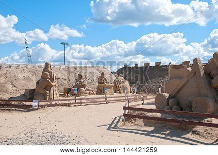 LAPPEENRANTA, FINLAND - AUGUST 8, 2016: Sand Sculptures and The Knight Sandcastle near Saimaa Lake