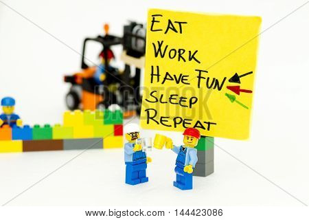 Orvieto, Italy - February 22th 2015: Lego men write in a notebook a motivational message. Lego is a popular line of construction toys manufactured by the Lego Group