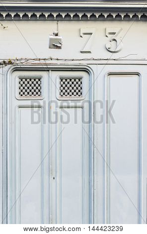 Antique Blue Wooden Doors Of A Store.