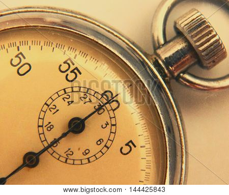 stopwatch retro vintage antiques macro closeup wallpaper background value measure time old clock arrow minute second accuracy timer record poster