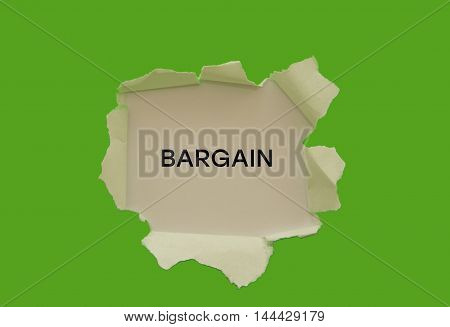 BARGAIN word written under torn paper .