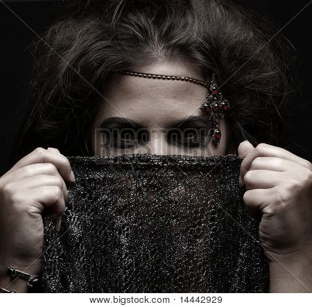 Portrait of arabic woman over dark background