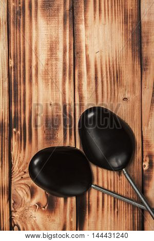 Plastic Black Shoetree On The Vintage Textures Wooden