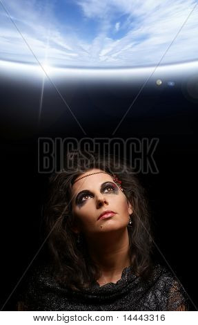 Portrait of witch over dark background