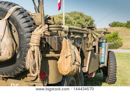Us Military Bag And Strings On A Jeep In Exhibition